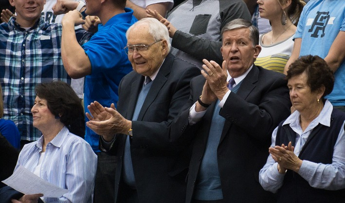 Elder Perry at a BYU basketball game with President and Sister Samuelson. Photo by Sarah Hill via The Digital Universe