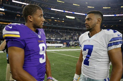 Minnesota Vikings wide receiver Jordan Leslie (9) and Dallas Cowboys quarterback Jameill Showers (7) talk after a preseason NFL football game Saturday, Aug. 29, 2015, in Arlington, Texas. (AP Photo/Brandon Wade)
