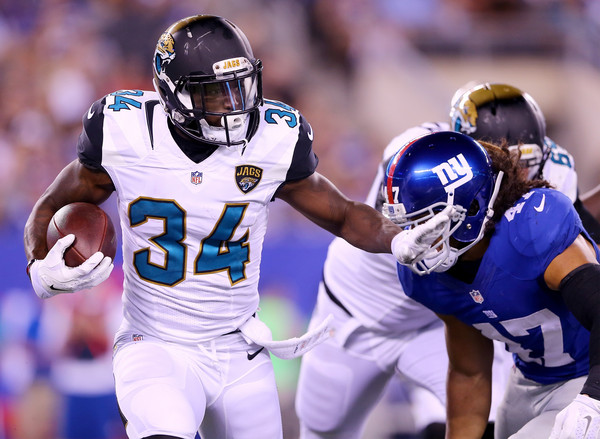 Storm Johnson #34 of the Jacksonville Jaguars carries the ball as Uani' Unga #47 of the New York Giants defends at MetLife Stadium on August 22, 2015 in East Rutherford, New Jersey. Source: Elsa/Getty Images North America