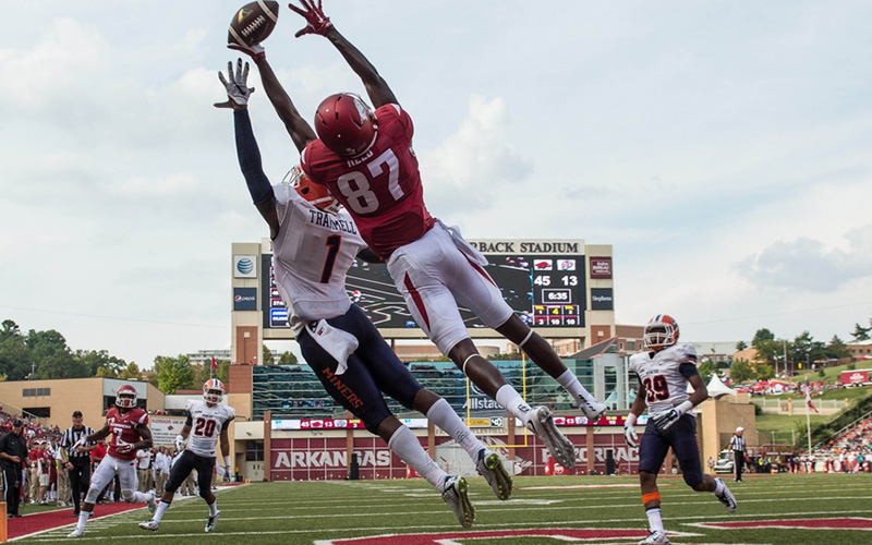 Sep 5, 2015; Fayetteville, AR, USA; UTEP Miners defensive back Trent Trammel (1) and Arkansas Razorbacks wide receiver Dominique Reed (87) leap for the ball in the end zone during the second half at Donald W. Reynolds Razorback Stadium. The Razorbacks defeat the Miners 48-13. Mandatory Credit: Jerome Miron-USA TODAY Sports